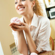 Portrait of young happy beautiful smiling blond woman eating cakes at home — Stock Photo #7542240