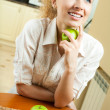 Stock Photo: Young happy smiling woman with apples, at home