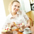 Young happy smiling beautiful young woman eating torte — Stock Photo #7543412