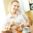 Young happy smiling beautiful young womeating torte — Stock Photo #7543412