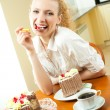 Young happy smiling beautiful young woman eating torte — Stock Photo #7543435