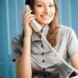 Businesswoman with phone and document working at office — Stock Photo