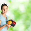 Woman with plate of fruits, outdoors — Stock Photo #7717292