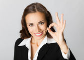 Happy business woman with okay gesture, over grey — Stock Photo