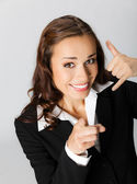 Businesswoman with call me gesture — Stock Photo