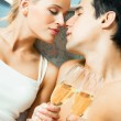 Young happy couple with champagne — Stock Photo