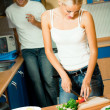 Couple making salad at home — Stock Photo