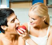 Couple playfully eating apple — Stock Photo