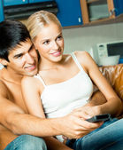 Young couple watching TV at home — Stock Photo