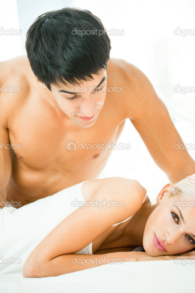 Young beautiful couple making love in bed  Stock Photo #7857723