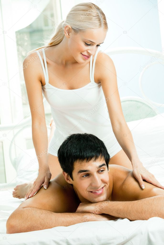 Young beautiful couple making massage in bed  Stock Photo #7857728