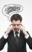 Businessman with confusing tangle of thoughts. — Stock Photo