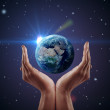 Hand holding earth. - Stock Photo