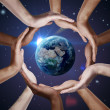 Royalty-Free Stock Photo: Conceptual symbol of the Earth with human hands around it.