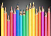 Group of coloured pencils with smiling faces representing a social network — Stock Photo