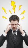 Young businessman with storm inside the head. — Stock Photo
