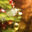 Stock Photo: Background with a Christmas tree and holiday lights.