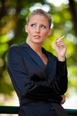 Young business woman smoking cigarette — Stock Photo