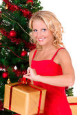 Young beautiful girl opening Christmas box — Stock Photo