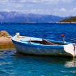 Lonely fishing boat - Stock Photo