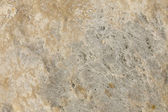 Texture of old yellow stone surface — Stock Photo