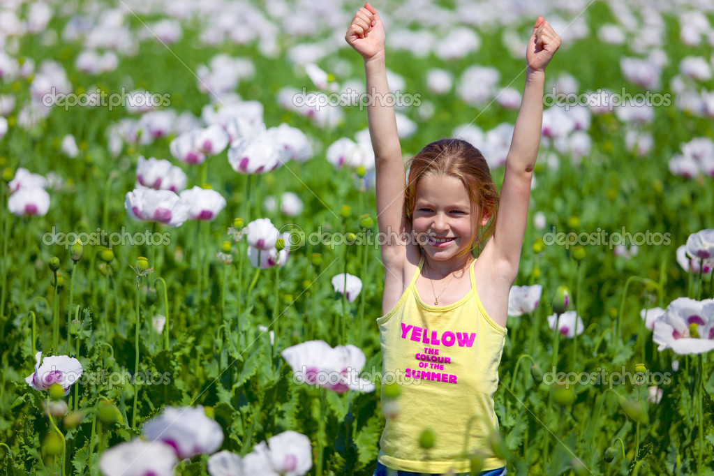 Young girl with hands up in field of white poppy — Stock Photo #6850831