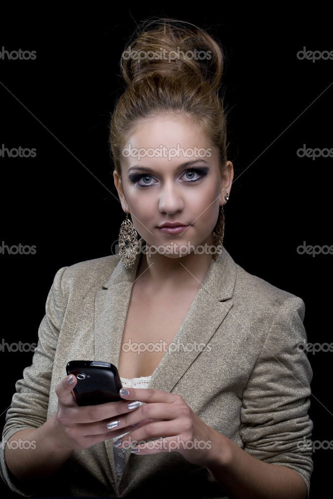 Young business woman with blue eyes, mobile phone, earrings and black background — Stock Photo #7322849
