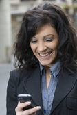 Sms and Smile of Young woman — Stock Photo