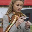 Woman with a cell phone in downtown — Stock Photo
