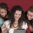 Three young girls with tablet pc — Stock Photo