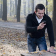Mobil phone and man with smile — Stockfoto