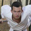 Karate training in autumn forest — Stockfoto