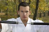 Nunchaku and karate — Stock Photo