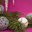 Christmas decoration with violett background - Stock Photo