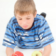 Royalty-Free Stock Photo: Boy chosing an apple