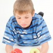 Boy chosing an apple — Stock Photo
