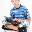 Young kid with laptop, isolated on white — Stock Photo