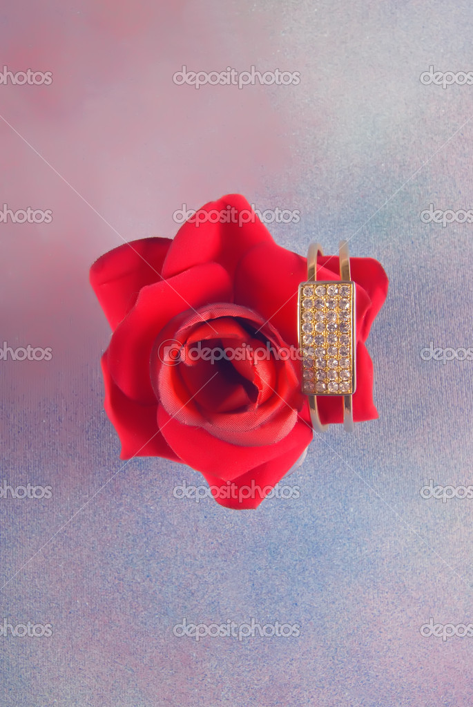 Big red blossomed rose with bracelet attached isolated on textured background — Stock Photo #6810551