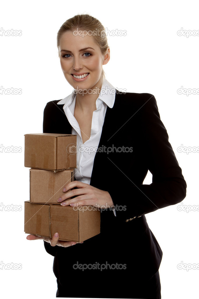 Young successful businesswoman holding small boxes ready for shipment.  — Stock Photo #7647222