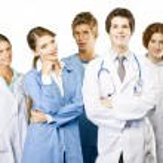 Group of smiling medical on white background — Stock Photo