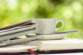 Cup of coffee with office equipment — Stock Photo