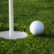 Ball and golf hole — Foto de Stock