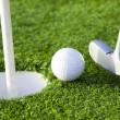 Ball and golf hole - Stock Photo