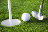 Ball and golf hole — Stock Photo