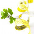 Stock Photo: Parsley leaf and measuring tape holder