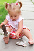 Very busy little girl — Stock Photo