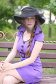 Beautiful girl in violet dress — Stockfoto