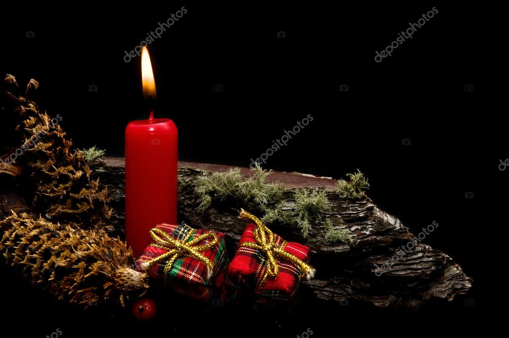 Christmas card with red candles on black background — Stock Photo #6919249
