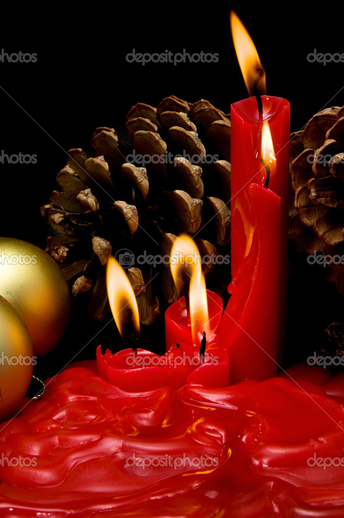 Christmas card with red candles on black background  Stock Photo #6919300