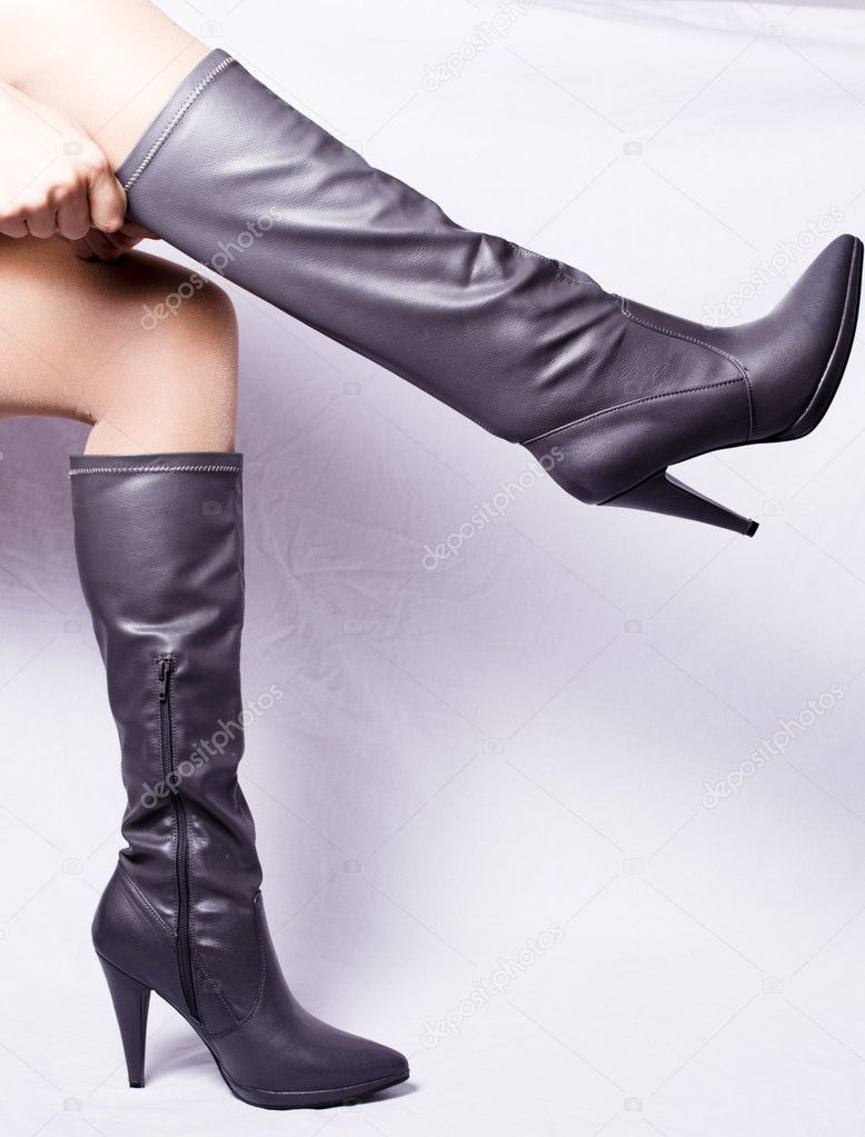 Pair of gray boots, white background, women's legs before winding — Stock Photo #6900692